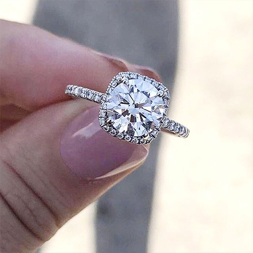round diamond with cushion halo engagement ring selfie