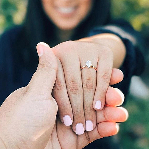 rose gold pear-shaped diamond engagement ring selfie