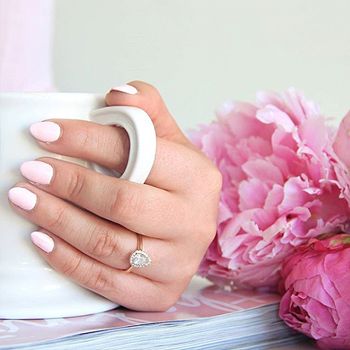 Pear shaped halo engagement ring selfie with coffee cup