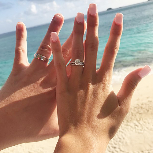 matching wedding band and diamond engagement ring engagement ring selfie on the beach
