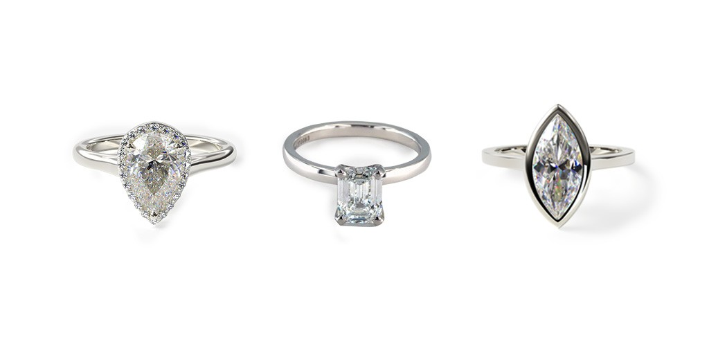 Engagement rings with elongated diamond shapes that look bigger than their carat weight: pear-cut diamond, emerald-cut diamond, and marquise diamond.