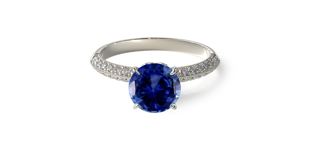 Pavé knife edge lotus basket engagement ring with sapphire