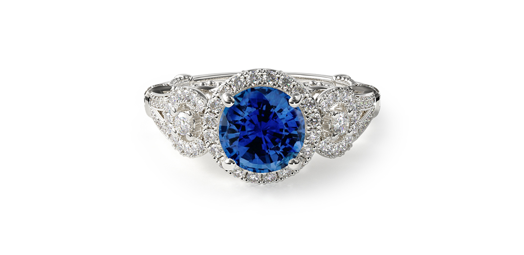 Three-Stone Decorative Bridge Engagement Ring with Round Cut Sapphire