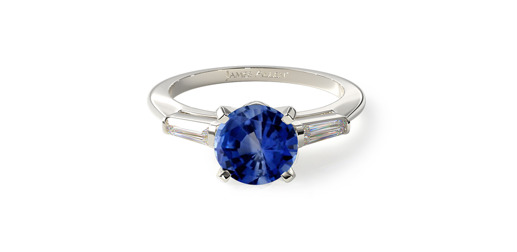 Three stone sapphire and diamond engagement ring with tapered baguette diamonds