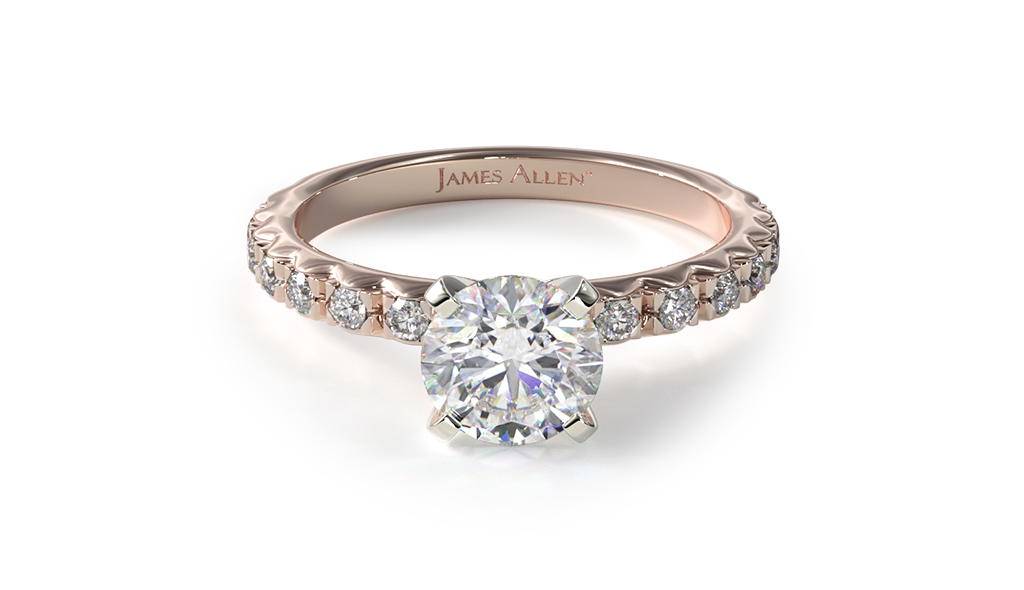 Rose Gold engagement ring with thin french-cut pavé set diamonds on the band