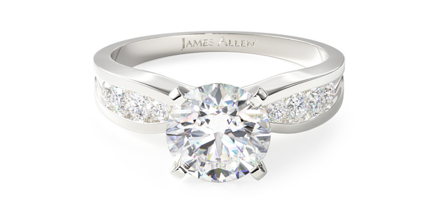 Round-cut engagement ring with channel-set diamonds