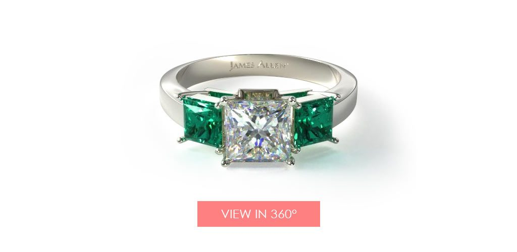 emerald three stone engagement ring