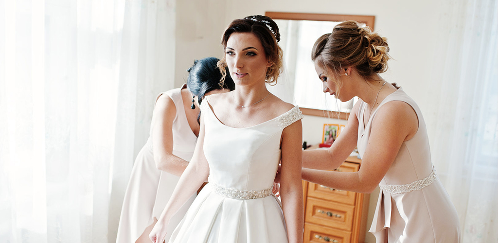 Give your bridesmaids priority primping in your wedding day schedule