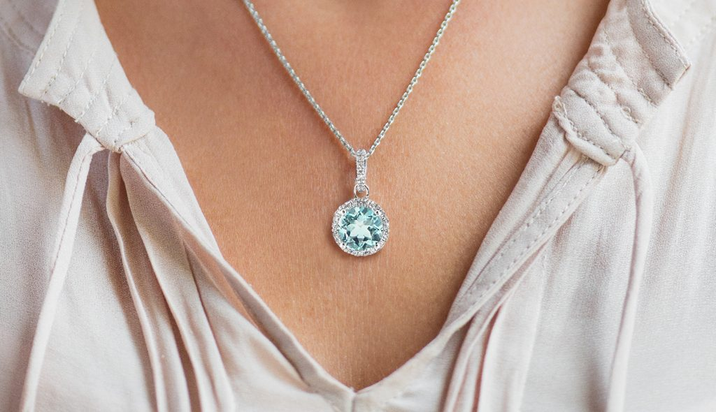 aquamarine diamond circle halo necklace march birthstone