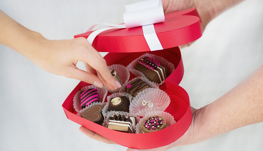 Valentine's Day gift idea heart-shaped box with diamond earrings inside