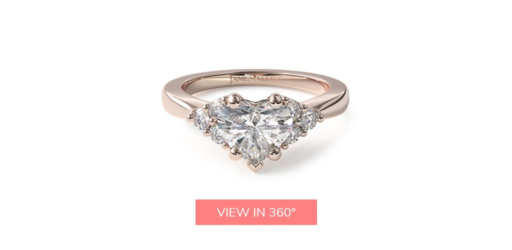 heart shaped diamonds side stone engagement ring