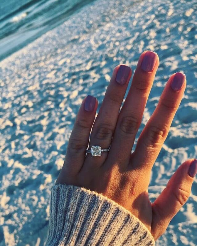 Engagement ring selfie on the beach with a platinum petite pavé diamond engagement ring