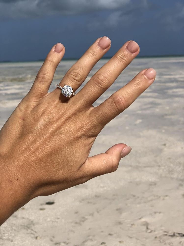 Engagement ring selfie on the beach