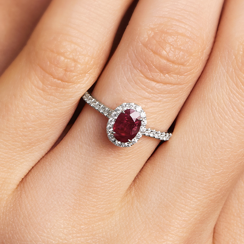 18K White Gold Oval Halo Ruby And Diamond Ring (7.0x5.0mm)