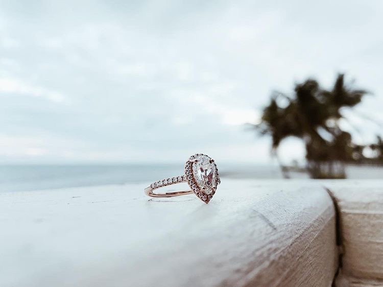 Pear shape halo engagement ring in 14k white gold