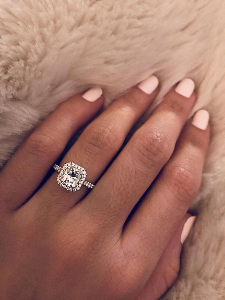 Halo engagement ring with round center diamond