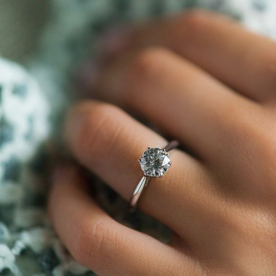 Trending solitaire engagement ring by Danhov