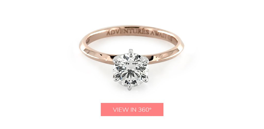 "engagement ring engraving: a rose gold ring inscribed with the phrase: ""adventures await us"""
