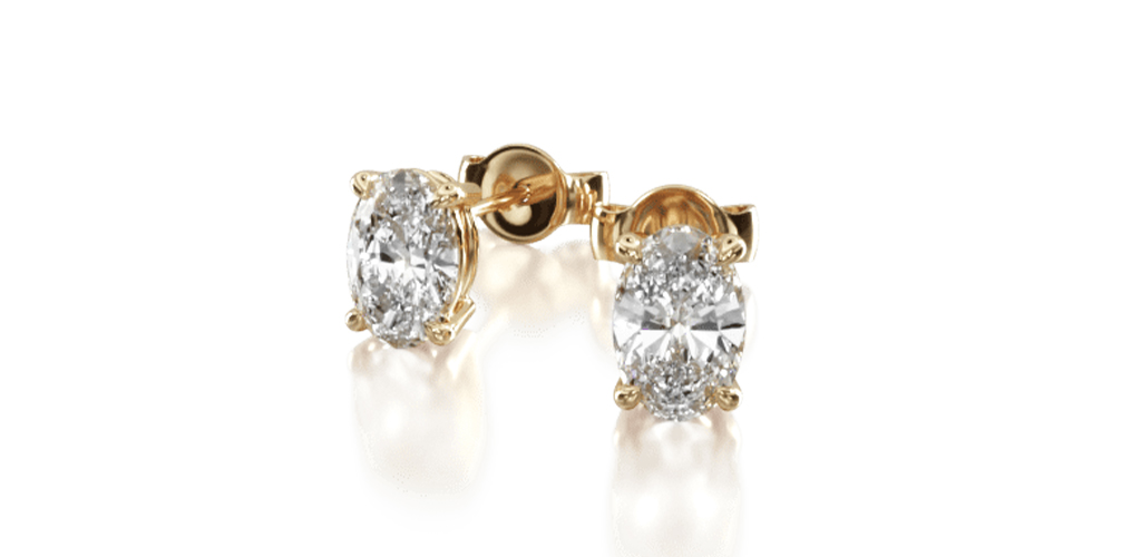 yellow gold diamond stud earrings oval cut four-prong earring settings