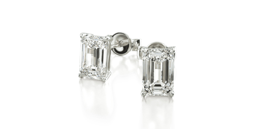 white gold diamond stud earrings emerald-cut diamond four-prong earring settings