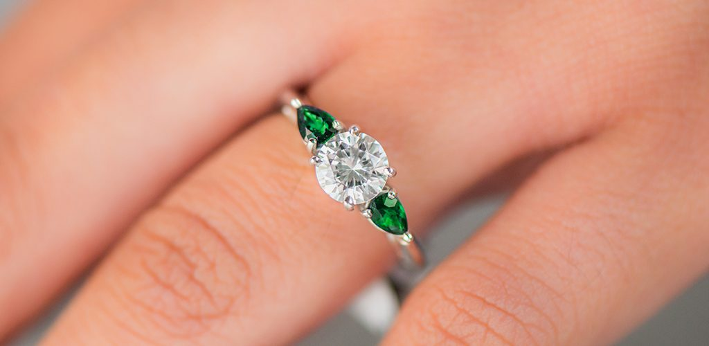 side stone emerald birthstone engagement ring