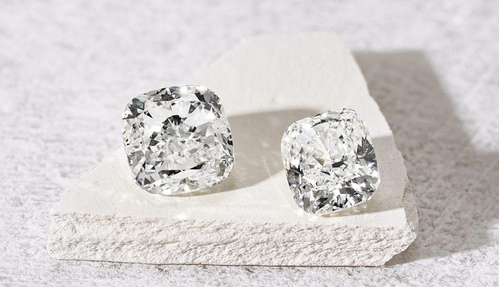 2 white diamonds on a stone