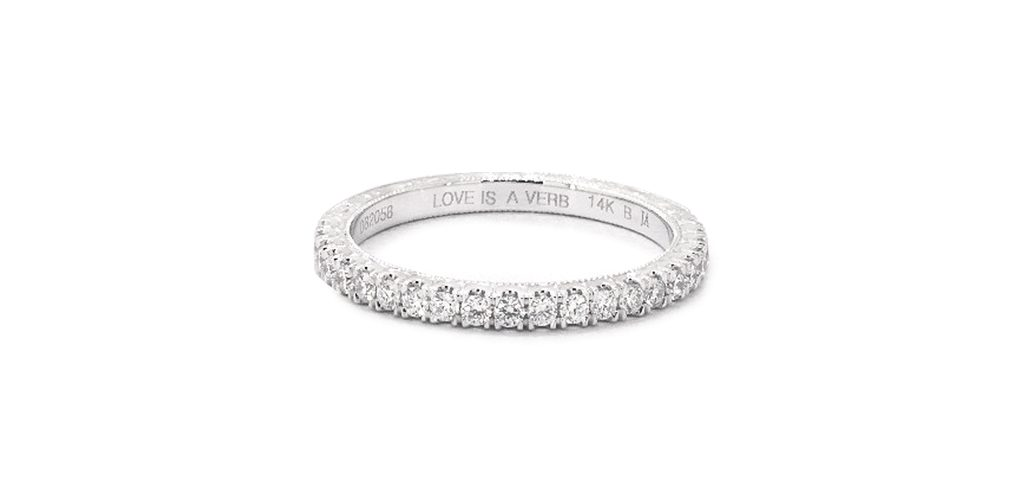"pave wedding ring engraved with ""love is a verb"""
