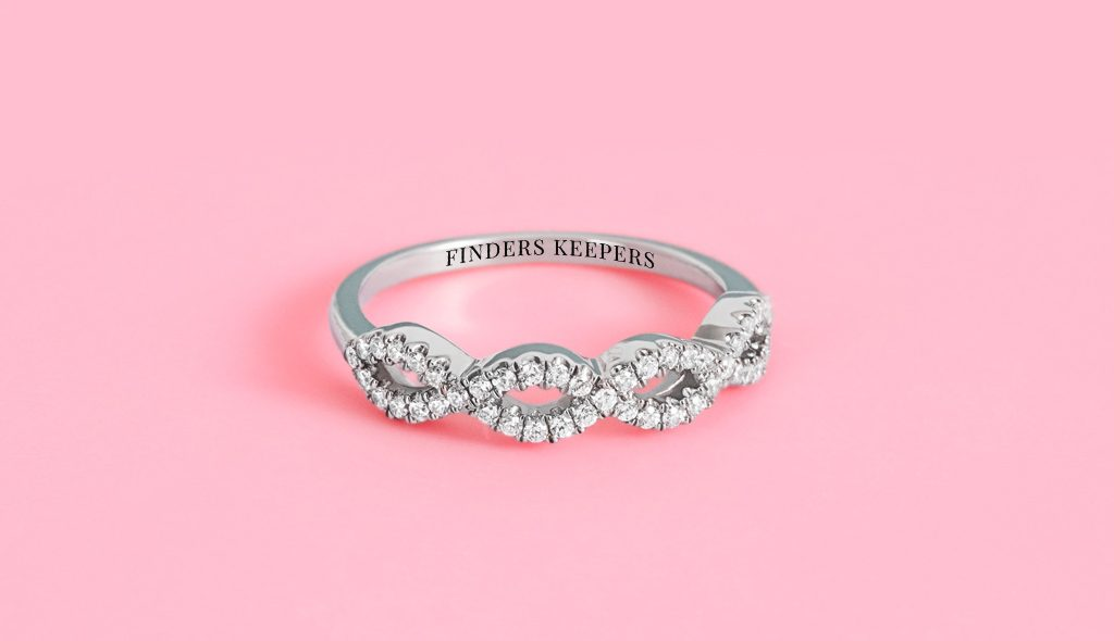 "pavé wedding ring engraved with the inscription ""finders keepers"""