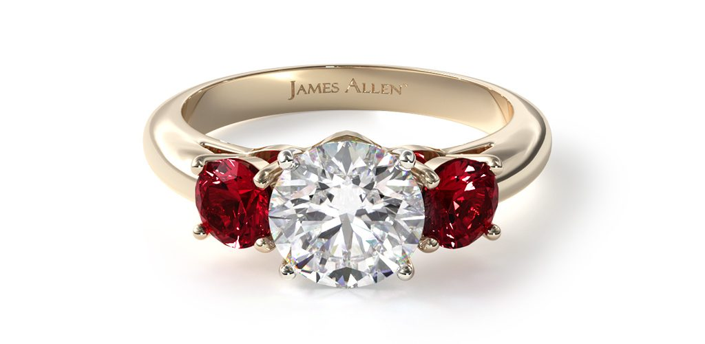 2020 engagement ring trends yellow gold three-stone round ruby