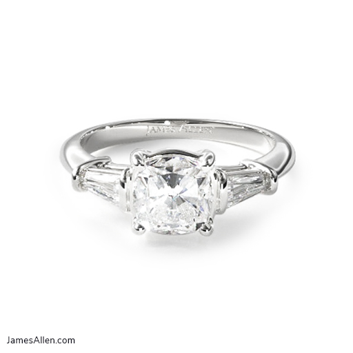 Tapered baguette diamond engagement ring in white gold.