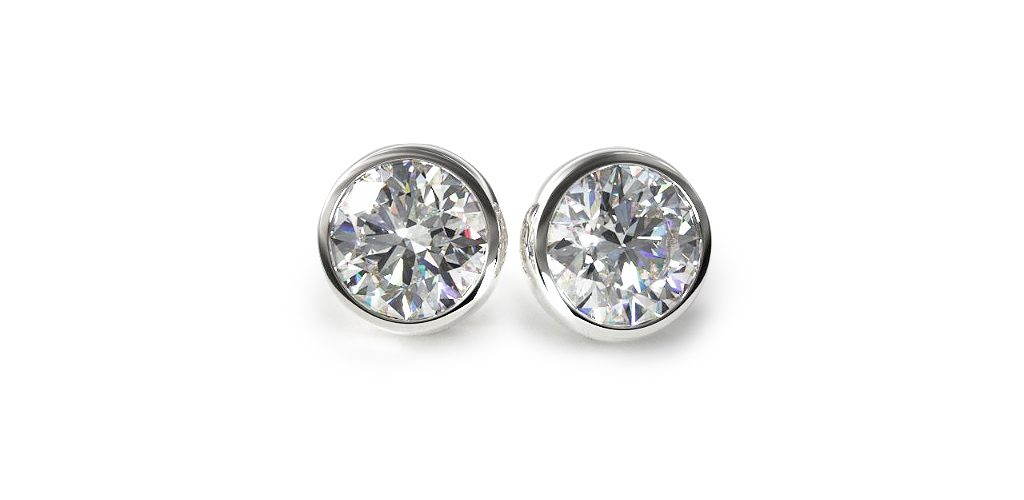 14K White Gold Pair Of Bezel Diamond Stud Earrings