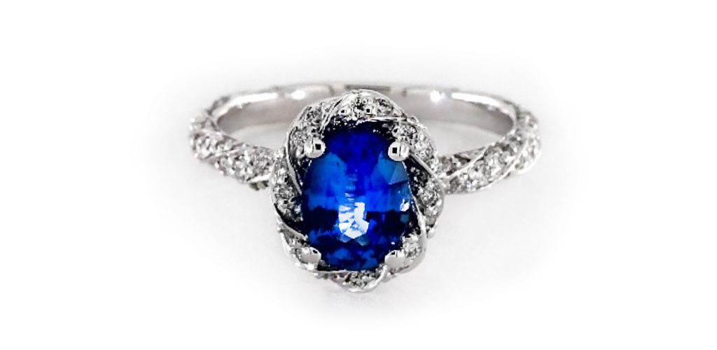 white gold blue oval sapphire gemstone engagement ring with twisted diamond halo and shank