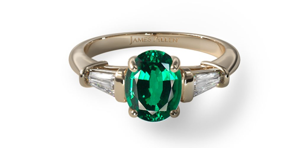 yellow gold oval-cut emerald gemstone engagement ring with baguette diamond side stones