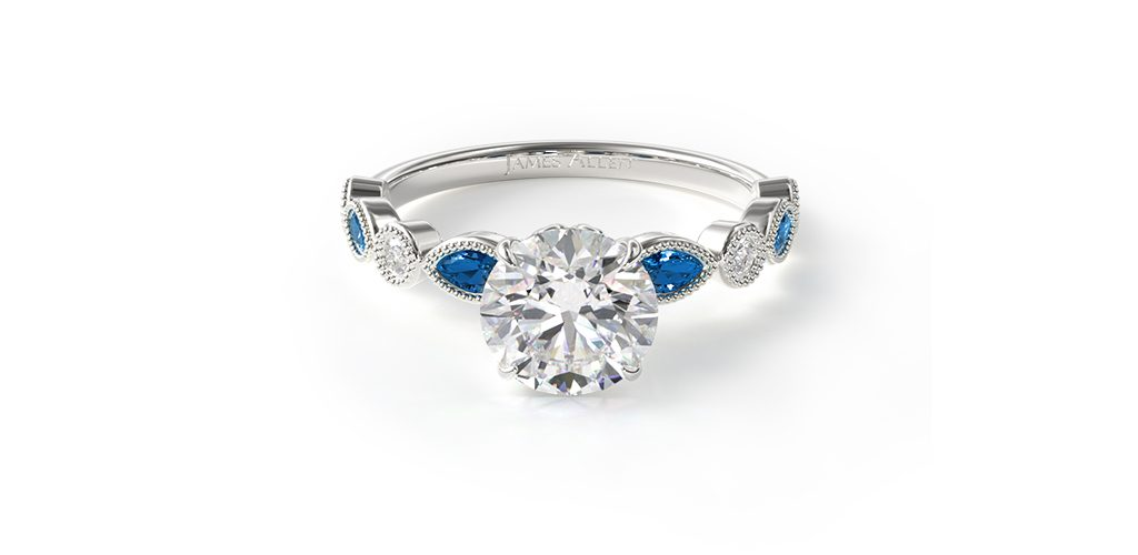 Affordable engagement rings: white gold diamond and sapphire engagement ring with round center diamond