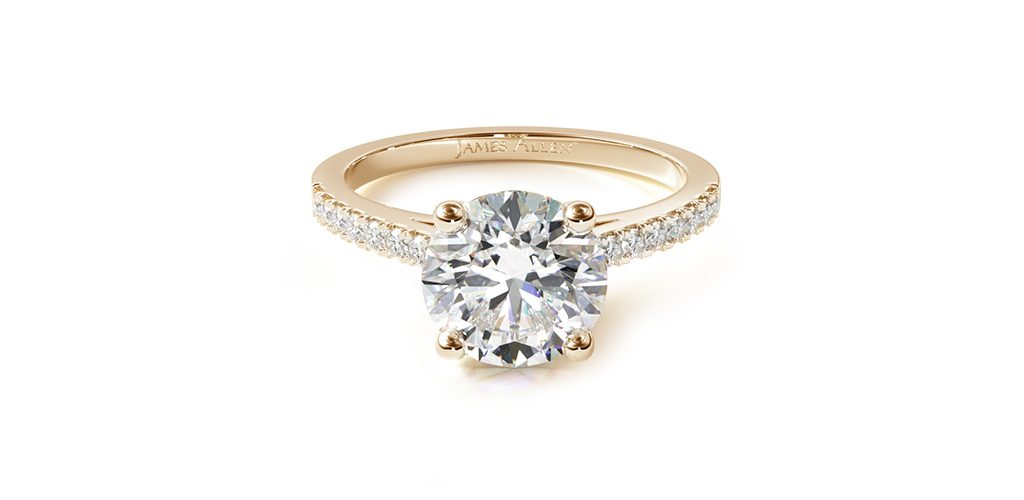 Affordable engagement rings: yellow gold petite pavé cathedral engagement ring with round center diamond