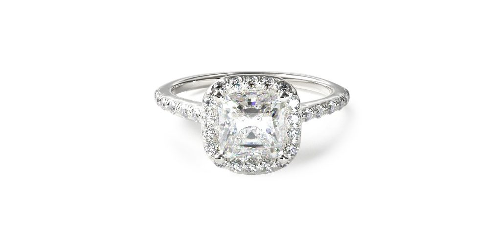 Affordable engagement rings: white gold pavé halo and shank engagement ring with a cushion-cut center diamond