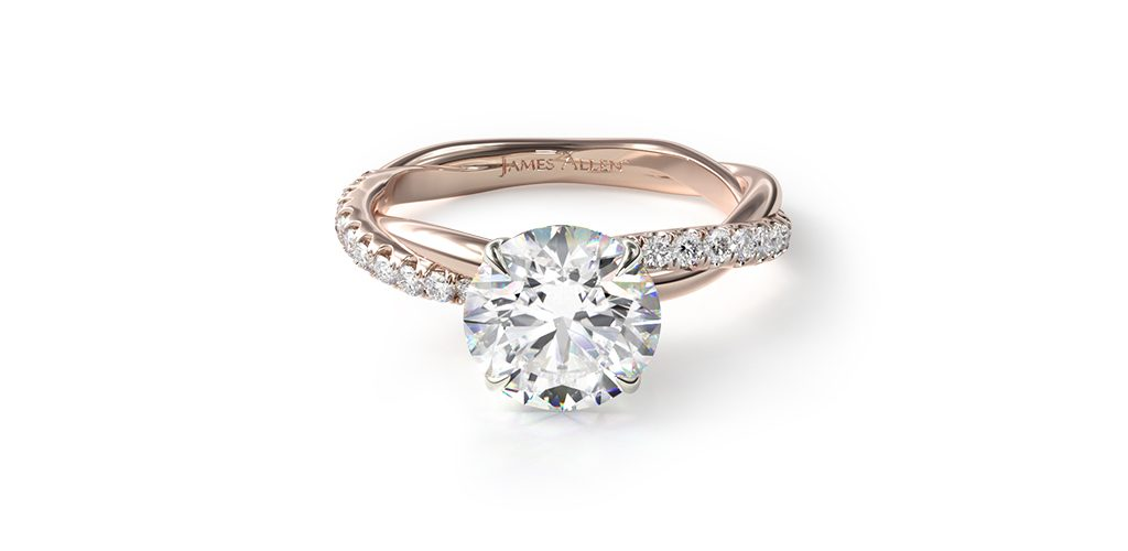 Affordable engagement rings: rose gold pavé rope engagement ring with round center diamond.