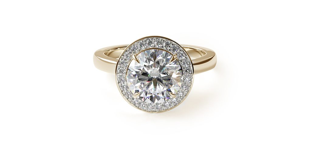 Affordable engagement rings: yellow gold diamond-encrusted halo engagement ring with round center diamond.