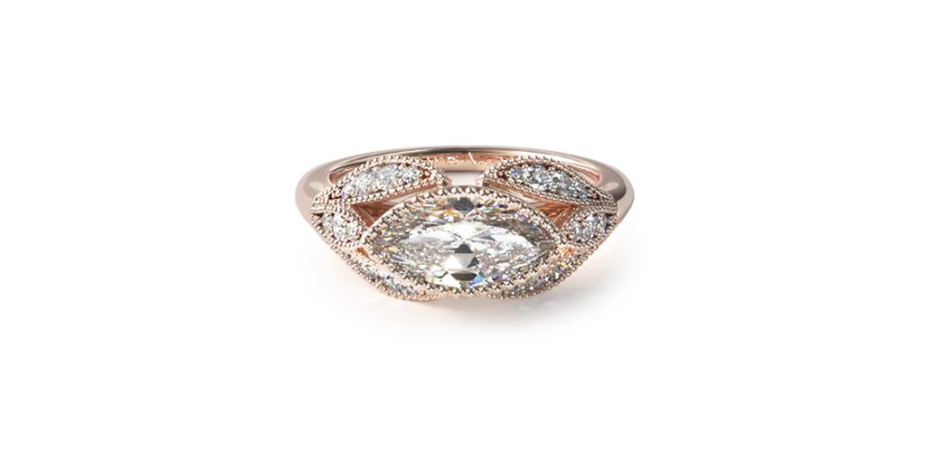Affordable engagement rings: rose gold beaded engagement with a marquise-cut center diamond.