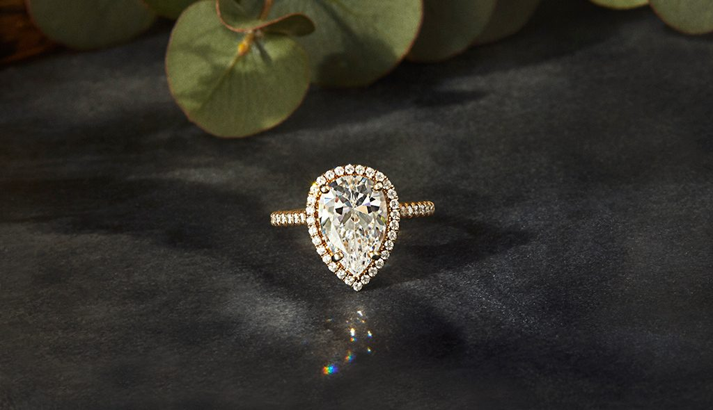 Affordable engagement rings: pear-cut diamond halo engagement ring