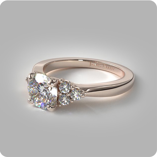 Using Pinterest to Find Your Partner's Dream Ring: Rose Gold Triple Diamond Cluster Engagement Ring.