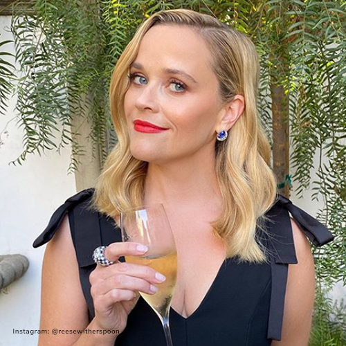 Reese Witherspoon wearing gemstone earrings