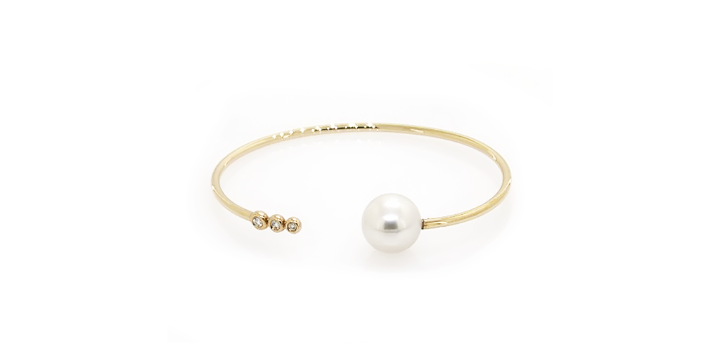 Yellow Gold Pearl Bangle - Winter Jewelry Guide