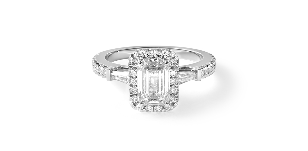 2021 engagement ring trends - tapered baguette emerald halo engagement ring