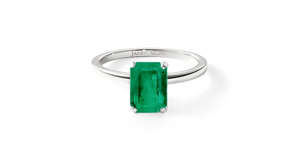 white gold comfort fit engagement ring with green emerald