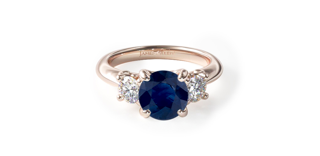 rose gold three stone engagement ring with sapphire stone