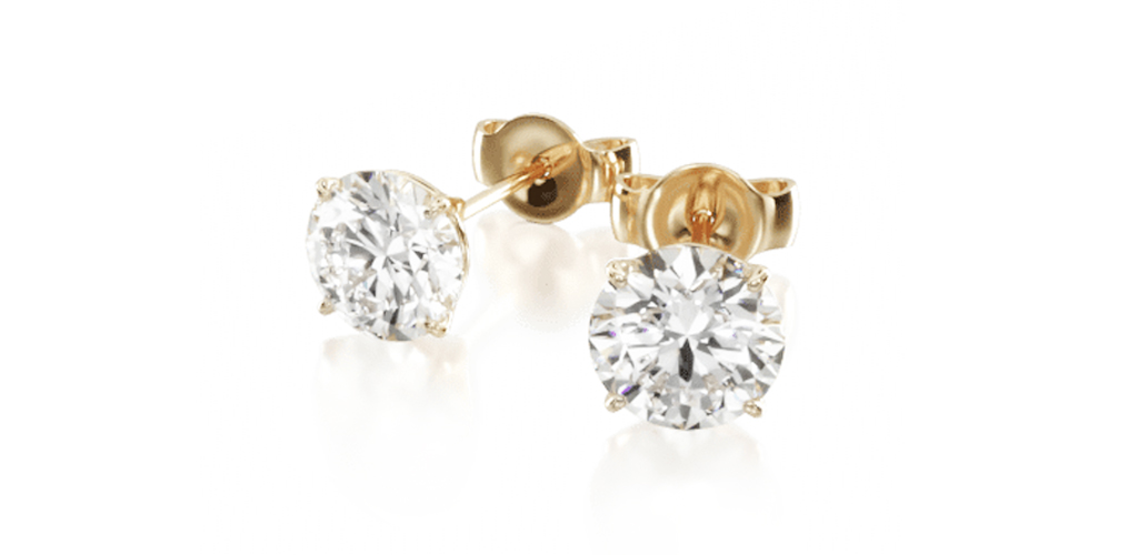 yellow gold four prong diamond stud earrings