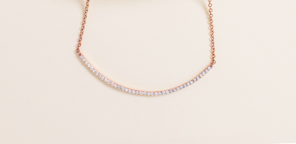 most popular fine jewelry: rose gold curved bar diamond necklace