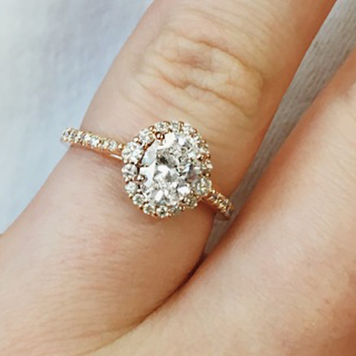 most popular engagement rings: rose gold pave halo engagement ring