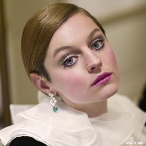 Emma Corrin with Halo emerald diamond drop earrings